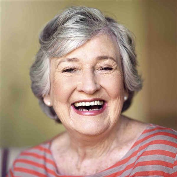 Gray haired woman smiling